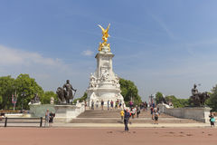 Tourists at Queen Victoria Memorial in front of the Buckingham Palace, London, United Kingdom. LONDON, UNITED KINGDOM - JUNE 21, 2017: Tourists at Queen Victoria Stock Photo