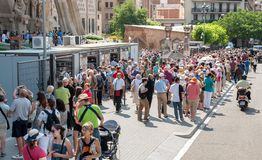 Tourists queue to buy tickets to visit The Sagrada Familia Cathedral in Barcelona royalty free stock photos