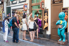 Tourists queuing for traditional belgian waffles. BRUSSELS, BELGIUM - AUG 22: Tourists queuing for traditional belgian waffles at the Manneken Pis statue. August Royalty Free Stock Photography