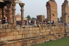 Qutub Minar. Tourists at Qutub Minar Complex, a UNESCO World Heritage Site located in Mehrauli, Delhi, India Royalty Free Stock Image