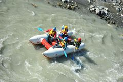 Tourists rafting on the mountain river Mzymta on a catamaran Royalty Free Stock Image