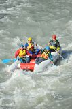 Tourists rafting on the mountain river Mzymta on a catamaran Royalty Free Stock Photo