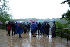 Tourists in the rain Royalty Free Stock Photos