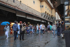 Tourists in the rain on Ponte Vecchio Royalty Free Stock Photo