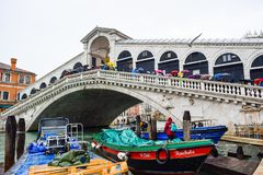 Tourists on a rainy day at Rialto Bridge on the Grand Canal in Venice, Italy. royalty free stock images