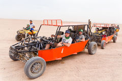 Tourists ready to race in desert Stock Photo