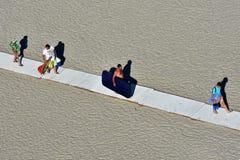 Tourists recreation on Mamaia beach Black sea coast. MAMAIA, CONSTANTA COUNTY, ROMANIA - AUGUST 11, 2018. Tourists recreation on Mamaia beach Black sea coast Stock Images