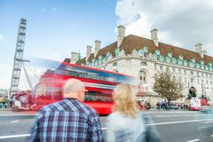 Tourists and red bus on Westminster Bridge, blurred view with lo. Ng exposure Stock Images