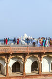 Tourists in the Red Fort in Agra with the Taj Mahal in the background Royalty Free Stock Photo