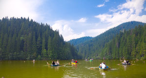 Tourists on the Red Lake. BICAZ, ROMANIA - AUGUST 17: Tourists with boats on the Red Lake on August 17, 2010 in Bicaz, Romania. The Red Lake and Bicaz Gorges are Royalty Free Stock Image