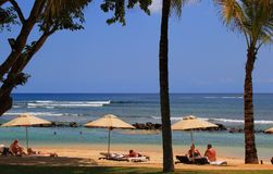 Tourists relax on the beach at Turtle Bay Mauritius Royalty Free Stock Photography