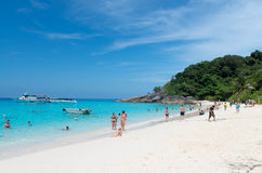 Tourists relax on idyllic tropical beach. SIMILANS ISLANDS, THAILAND - MARCH 18, 2014: Tourists relax on idyllic tropical beach Ko Miang island, Mu Ko Similan Royalty Free Stock Image