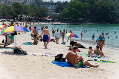 Tourists relax on Kata beach Royalty Free Stock Images