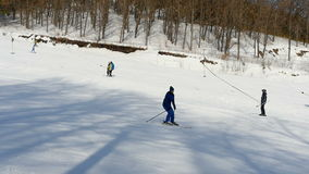 Tourists relax at the mountains ski resort stock video
