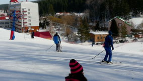Tourists relax at the mountains ski resort stock video footage