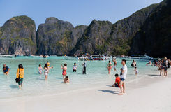 Tourists relax on Phi Phi Leh island Stock Images