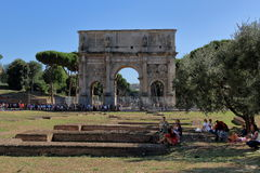 Tourists relax in the shade of a tree in Rome Royalty Free Stock Image