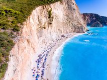 Tourists relaxing on the Beach in Porto Katsiki Lefkada Greece. Greek Island Lefkada in the Mediterranean Sea is a well known tourist destination for the royalty free stock photos