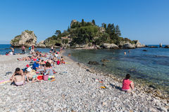 Tourists relaxing at the beach of Taormina at Sicily, Italy Royalty Free Stock Photos