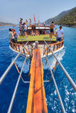 Tourists relaxing on board excursion boat in waters of Mediterra Royalty Free Stock Photos