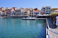 Agios Nicolaos, Crete Island / Greece. Tourists and local people are relaxing at the cafes next to the sea in Agios Nikolaos stock photos