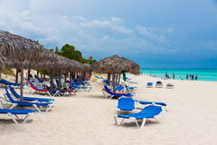 Tourists relaxing in a cuban beach Royalty Free Stock Photos
