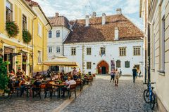 Tourists Relaxing Downtown In The Old Center Of Cluj Napoca stock photography
