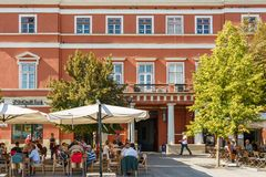 Tourists Relaxing Downtown In The Old Center Of Cluj Napoca royalty free stock image