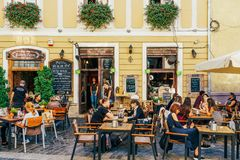 Tourists Relaxing Downtown In The Old Center Of Cluj Napoca royalty free stock photography