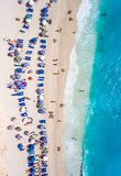 Tourists relaxing on the Egremni Beach in Lefkada swimming and p. Laying games in the water aerial view stock photo
