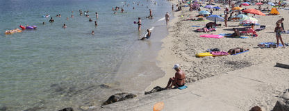 Tourists relaxing on the Magaluf beach in Majorca Stock Photo