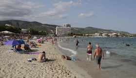 Tourists relaxing on the Magaluf beach in Majorca Stock Photography