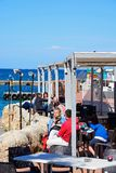 Pavement cafe, Melleiha. Tourists relaxing at a pavement cafe in the harbour, Mellieha, Malta, Europe Royalty Free Stock Images