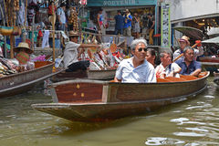Tourists relaxing on wooden boat at floating market around Bangkok area Stock Photography