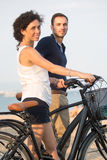 Tourists with rented bikes. Tourists on holidays watching in the camera Royalty Free Stock Photos