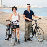 Tourists with rented bikes Royalty Free Stock Photos