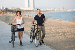 Tourists with rented bikes walking stock photos
