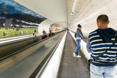 Tourists and residents are going on a very long underground esca Stock Images