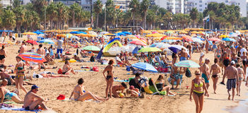 Tourists rest along Salou beach Stock Images