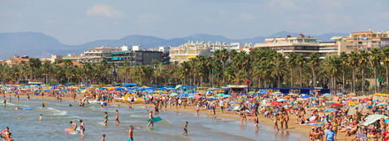 Tourists rest along Salou beach Royalty Free Stock Photos