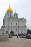Tourists rest on benches in Moscow Kremlin. Royalty Free Stock Image