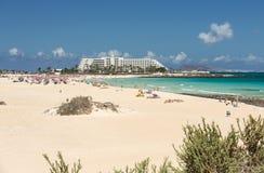 Tourists rest on Corralejo Beach on Fuerteventura Stock Photography