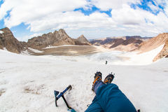 Tourists rest in the mountains on the glacier. First-person view. Sayram, Kazakhstan. Tourists rest in the mountains on the glacier. First-person view Royalty Free Stock Images