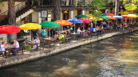 Tourists at Restaurant Along the San Antonio River Walk in Texas Stock Photography