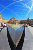 Tourists resting on a granite fence fountain Stock Photography