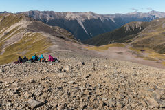 Tourists resting on mountain range. In Nelson Lakes National Park in New Zealand Stock Photos