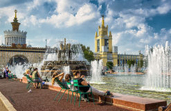 Tourists are resting near the Stone Flower Fountain in Moscow Stock Photos