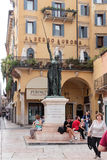Tourists resting in the square Piazza Delle Erbe in Verona Royalty Free Stock Photos