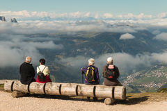 Tourists resting on wooden bench Royalty Free Stock Photo