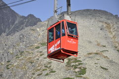 Tourists return by cable car from the summit of Lomnica in the T Royalty Free Stock Photo